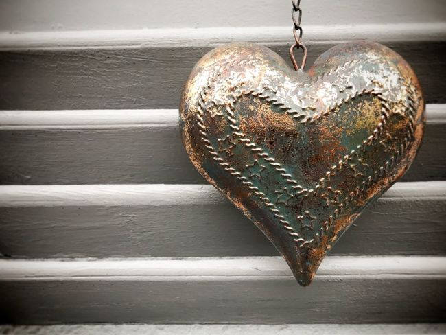 Metal heart on wood shutters Copy Space Nobody Metal Herz Valentine's Day  Valentine Heart Shape Love Positive Emotion Close-up Emotion No People Indoors  Wood - Material Shape Hanging Decoration Pattern Single Object Brown