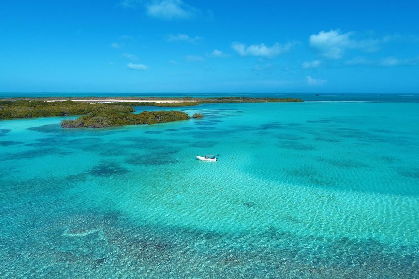 Aerial view of island and beach in Los Roques, Venezuela Water Sea Nautical Vessel Scenics - Nature Beauty In Nature Transportation Tranquility Sky Tranquil Scene Blue Land Nature Day Island Turquoise Colored Tropical Climate Outdoors Travel Destinations Holiday Horizon Over Water No People Lagoon Los Roques Madrisqui Caribe Caribbean Caribbean Life Caribbean Island Francisqui Crasqui Carenero's Beach Cayo De Agua Venezuela