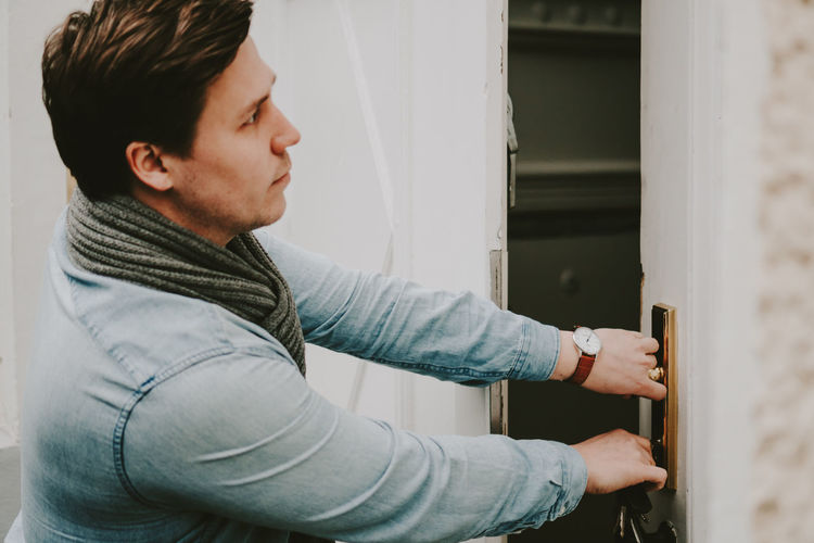 Young Man Entering House