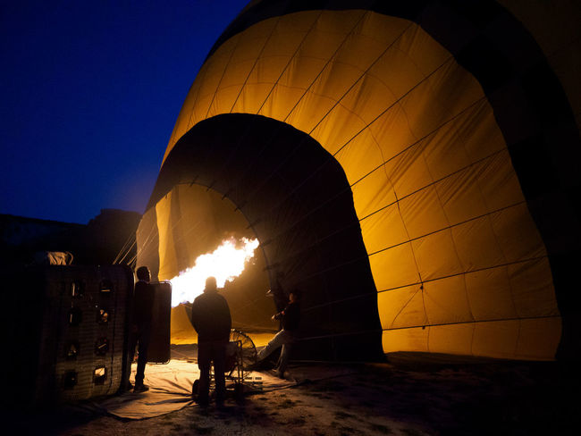 Cappadocia/Turkey Filling Up Hot Hot Air Balloons Travel Turkey Working Air Vehicle Balloon Burning Early Morning Excitement Fire Flame Heating Hot Air Balloon Hot Air Ballooning Mode Of Transportation Nature Preparation  Preparing Silhouette Sky Standing Transportation