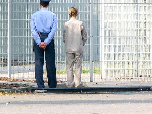 Back Side Fence Friendship Outdoors Prison Prisoner Two People Uniform