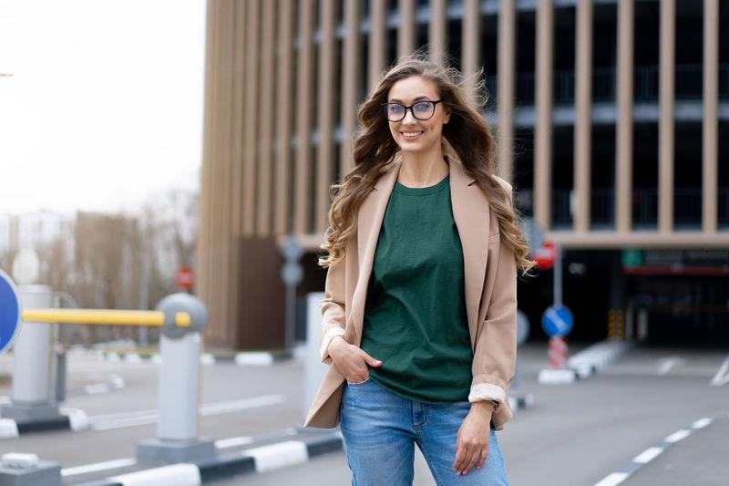 Portrait of woman wearing eyeglasses standing outdoors