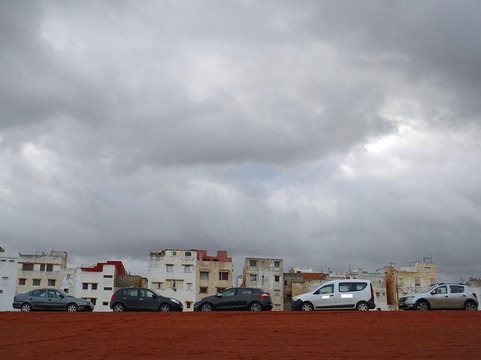 Architecture Auto Automobile Ciel Ciel Et Nuages City Cityscape Cloud - Sky Day Nature No People Outdoors Quartier Sky Storm Cloud Transportation Voitures