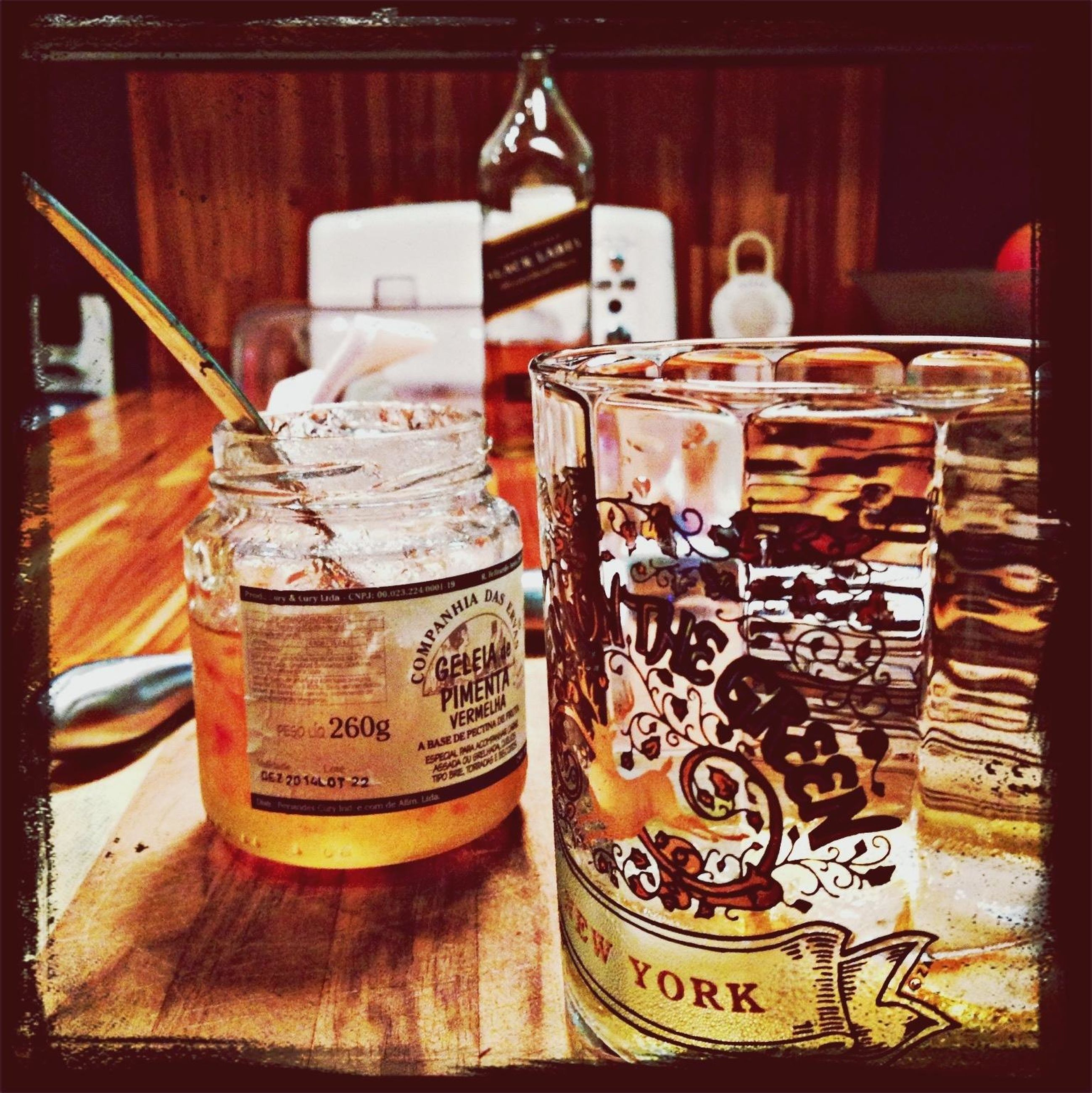 indoors, table, still life, food and drink, text, drink, wood - material, no people, western script, close-up, jar, communication, auto post production filter, focus on foreground, container, freshness, day, shelf, restaurant, absence