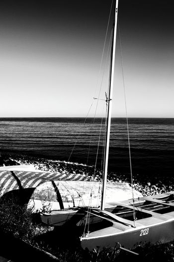 Sea Water No People Horizon Over Water Clear Sky Outdoors Nautical Vessel Nautical Sign Shadow And Light Shadows And Backlighting Blackandwhite Monochrome Photography El Campello Blackandwhite Photography Travel Destinations Industrial Ship Ships At Sea Ship At Sea Transportation Peaceful Place Cityscape Horizon Over Sea Tranquility Beach Nautical Port