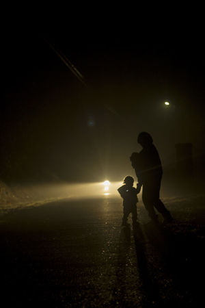 Family winter walks Family❤ Foggy Weather Childhood Illuminated Love Mother Daughter  Mother Son Love Night Nigth  Outdoors People Real People Silhouette Standing Togetherness Two People AI Now