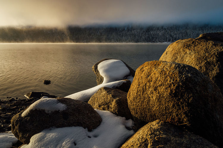 Winter sunrise at Donner Lake, California. California Donner Lake Truckee  Winter Beauty In Nature Day Fog Lake Nature No People Outdoors Pebble Beach Rock - Object Scenics Sky Snow Sunset Tranquility Water