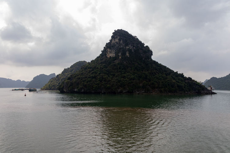 Ha Long Bay islands Vietnam Water Sky Scenics - Nature Beauty In Nature Mountain Cloud - Sky Tranquil Scene Sea Tranquility Nature Waterfront Day Idyllic Non-urban Scene Land Rock No People Outdoors Rock - Object Bay Mountain Peak Ha Long Bay Ha Long Bay Cruise Vietnam Vietnam Trip ASIA Landscape Landscape_Collection Landscape_photography