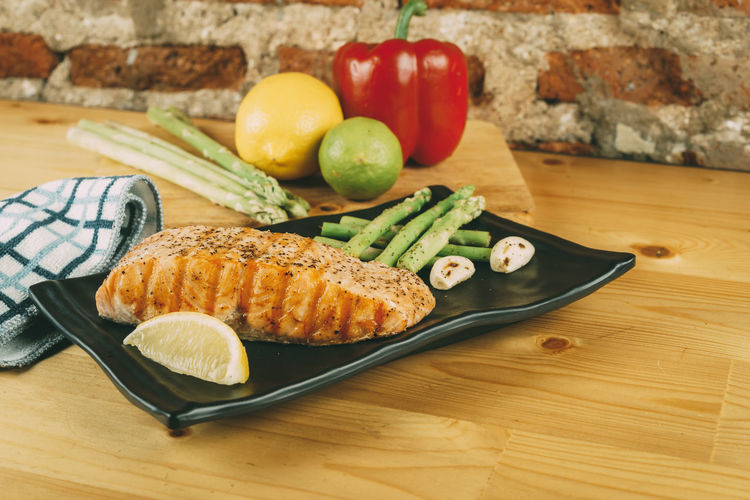 Chopping Board Close-up Cutting Board Day Food Food And Drink Fork Freshness Healthy Eating High Angle View Indoors  Meat No People Ready-to-eat Salmon SLICE Still Life Table Tomato Vegetable Wood - Material