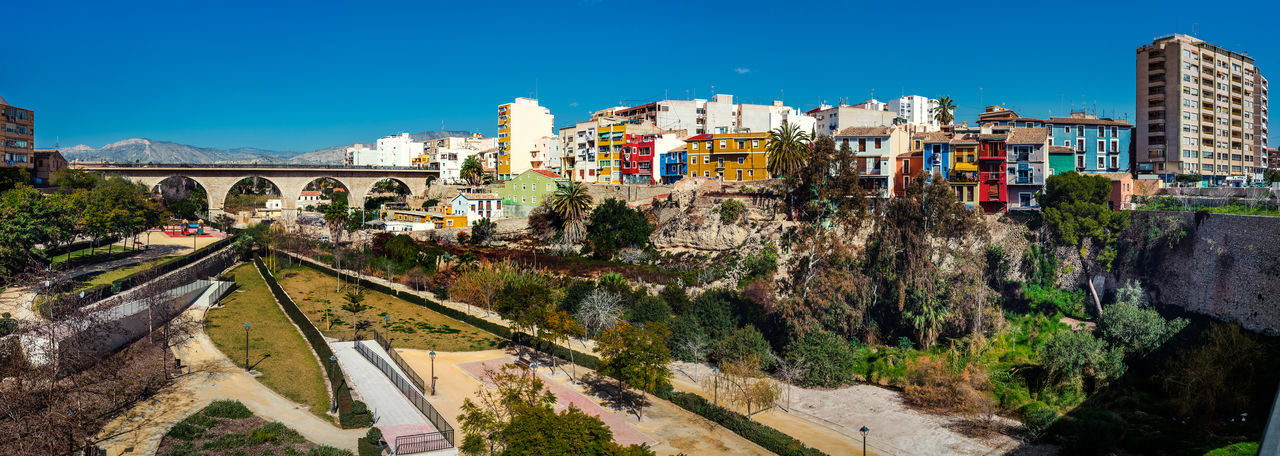 Panorama of Villajoyosa / La Vila Joiosa town. Coastal town of Costa Blanca. Province of Alicante, Valencian Community, Spain Alicante, Spain Blue Sky Bridge Colorful Costa Blanca Famous Place Houses La Vila Joiosa Landscape Multi Colored Panorama Panoramic Picturesque Village Residential Building Scenery South SPAIN Street Sunny Day Tourist Resort Town Travel Destinations Tropical Climate Typical Houses Villajoyosa