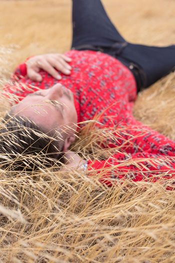 Low section of woman lying on field