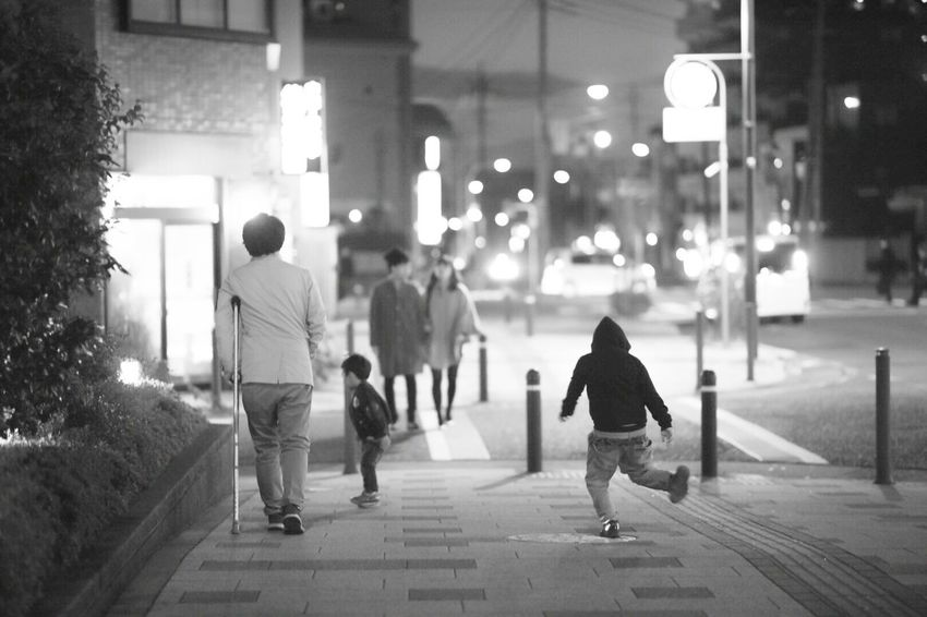 Walking Street Focus On Foreground City Life City Rear View Real People Night Outdoors Illuminated Lifestyles Men Winter