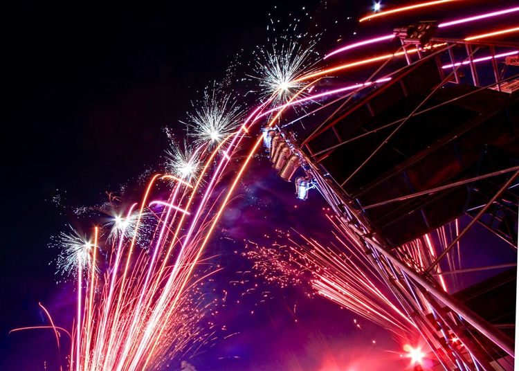 Night Illuminated Motion Celebration Event Firework Long Exposure Arts Culture And Entertainment Glowing Firework Display Exploding Low Angle View Blurred Motion No People Light Sparks Firework - Man Made Object Sky Smoke - Physical Structure Multi Colored
