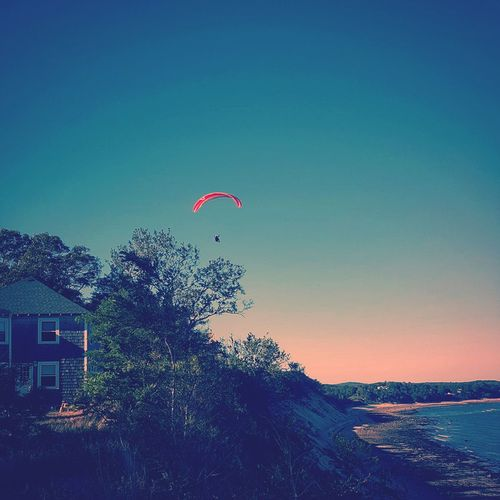 cape cod gliders Flying Mid-air Gliding Hanggliding At Beach Hangglider Nature Blue Sea Day Beauty In Nature Outdoors Clear Sky Tree Cape Cod Calm Check This Out Beach Seascape Coastline Scenics Capecod Pink Color Nature Sky Distant