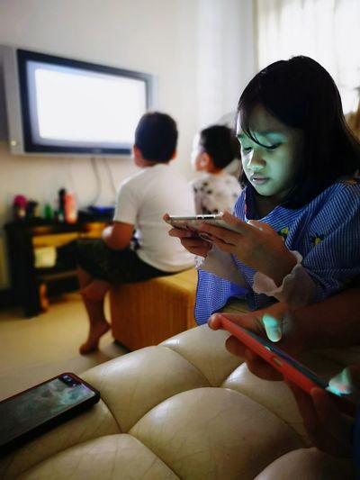 Girl using smart phone at home
