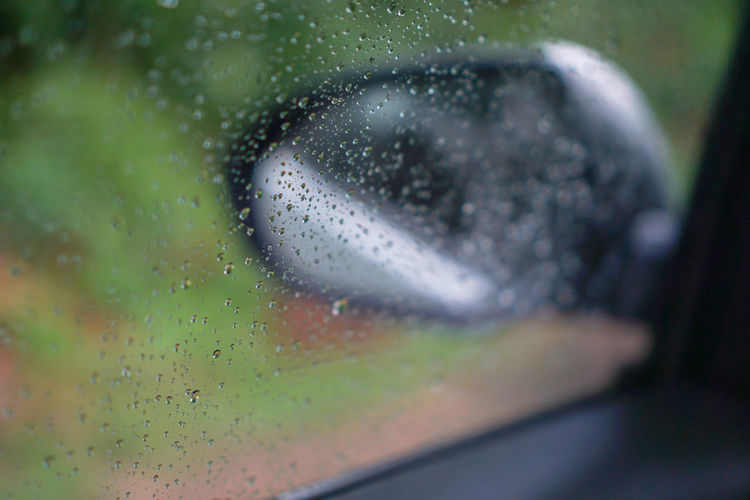 blur backgruond,Rain water on the car glass Close-up Selective Focus Water Glass - Material Drop Wet No People Indoors  Nature Transparent Window Rain Green Color Full Frame Extreme Close-up Land Vehicle Vehicle Interior Detail RainDrop