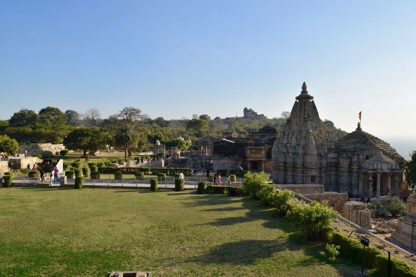 View of Temple from Tower of Victory Ancient Civilization Architecture Chittorgarh Fort Clear Sky Day Heritage Site History No People Outdoors Place Of Worship Rajasthan Religion Sky Tourism Travel Travel Destinations Tree Vacations