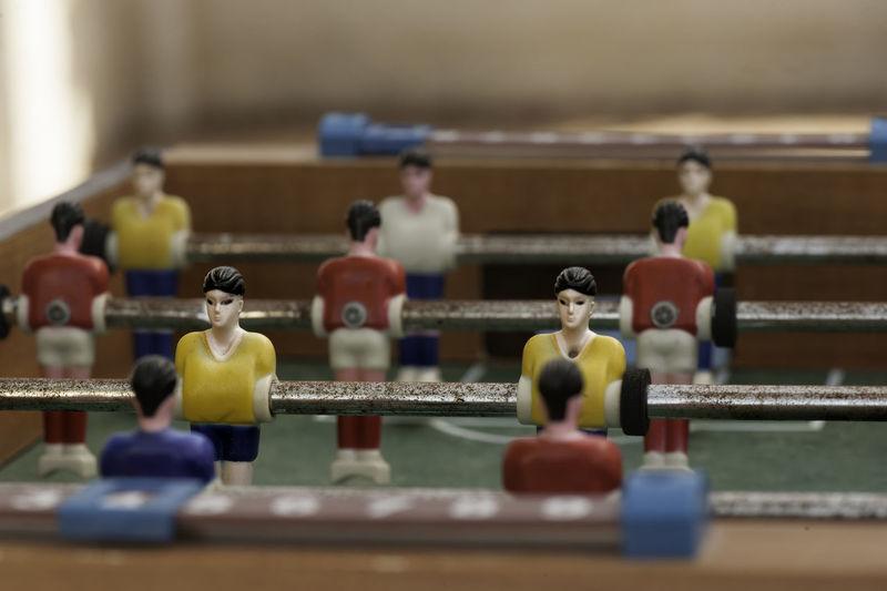 Close-up of figurines on foosball table