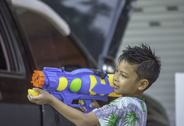 Boy playing with squirt gun