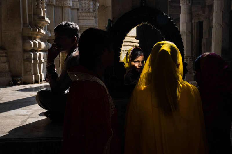 A married Indian woman putting on a bindi. ASIA Asian  India Indian Woman Indian Culture  Bindi Kumbhalgarh People Rajasthan Sari Street Photography Temple Travel Destinations Veiled Veiled Woman Yellow EyeEmNewHere