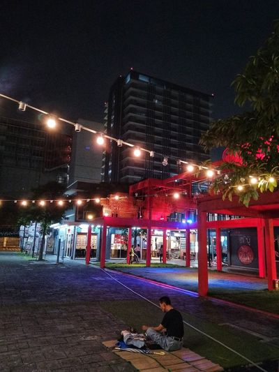 Simple life on ground Suanluang Square Night Illuminated Architecture Street City Nightlife building exterior Cold Temperature Outdoors Winter People Tree Sky Cityscape umbrella nightlight light Rethink Things