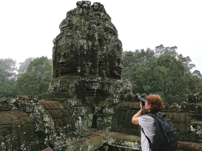 woman take a photo in Angkor Wat Angkor Wat, Cambodia Coulture Old Place Poupular Travilling Human Connection Pixelated Tree Spraying Standing Sky Fountain Growing Splashing Waterfall High-speed Photography Splashing Droplet Surf