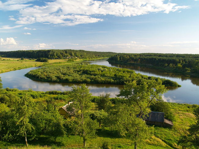 Nemunas river loop in Merkinė, Lithuania. View from Merkinė mound. Beauty In Nature Cloud - Sky Day Grass Green Color Lake Landscape Nature Nemunas No People Outdoors Reflection River Loop Scenics Sky Tranquil Scene Tranquility Tree Water