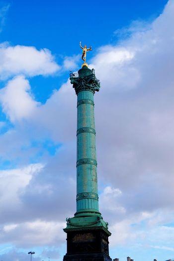 Low angle view of july column at place de la bastille against sky