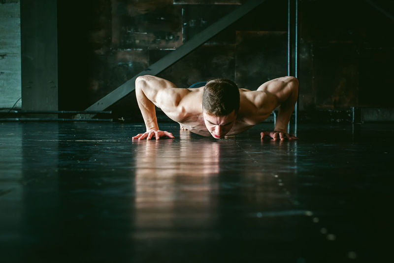 Athlete Athlete Day Exercising Gym Handstand  Health Club Healthy Lifestyle Indoors  Lifestyles Mammal Men Muscular Build One Person People Real People Reflection Shirtless Sport Sports Clothing Sports Training Strength Water Young Adult