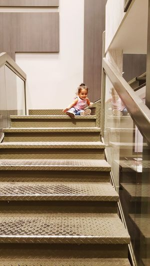 Girl Playing On Staircase