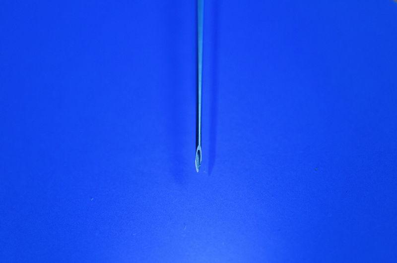 Full frame shot of metal grate against blue background