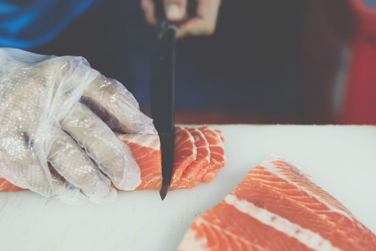 Close-up Fish Focus On Foreground Food Food And Drink Freshness Hand Healthy Eating Human Body Part Human Hand Indoors  Japanese Food Meat One Person Ready-to-eat Real People Rice Sashimi  Seafood Sushi