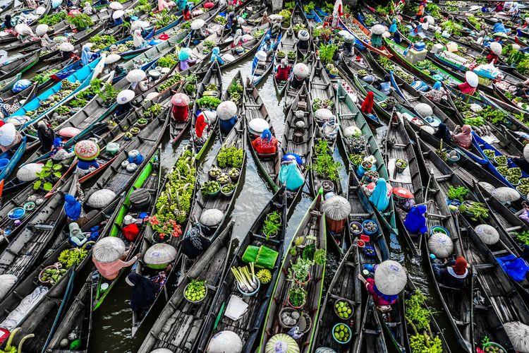 High angle view of boats on lake at market
