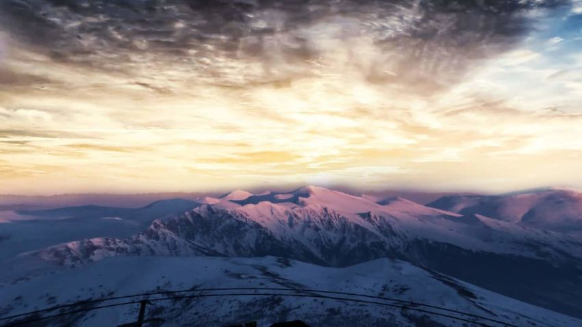 Nature Snow Cloud - Sky Mountain Scenics Winter Beauty In Nature Sunset Cold Temperature Landscape No People Tranquil Scene Mountain Range Sky Tranquility Nature Mountain Peak Outdoors Day