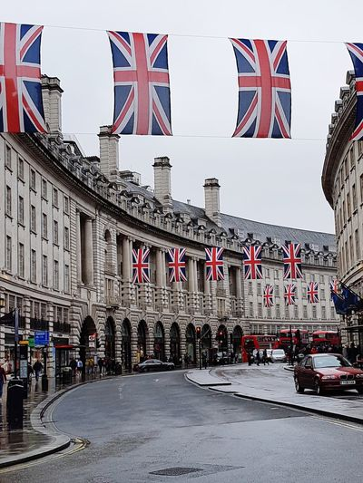 beautifully British Red London London Bus Regent Street  Flag Flags Rainy Days City Patriotism Flag Cultures Sky Architecture National Icon