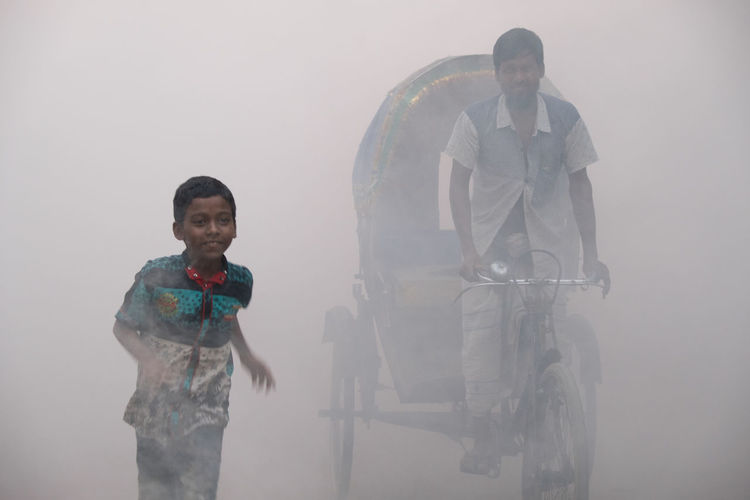 Fujifilm Fujifilm_xseries Fuji Fuji Xt20 Streetphotography Street Bangladesh Light Smoke Real People Young Men Looking At Camera Two People People Portrait Fog Front View Lifestyles Males  Street In Color