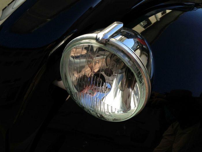 Close-up of vintage car headlight