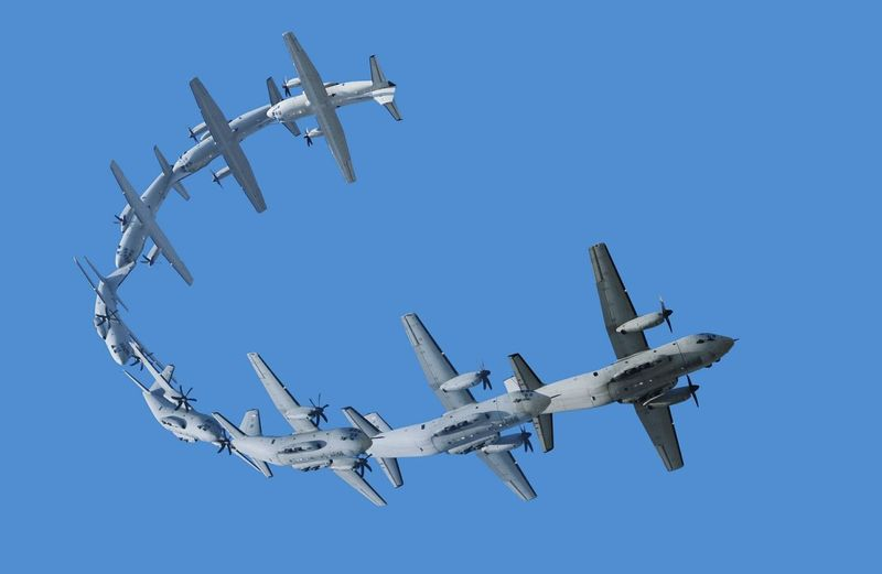 Multiple image of airplane flying against clear blue sky