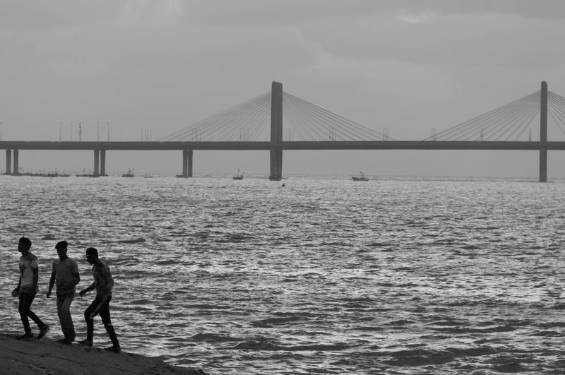 Architecture Bridge Bridge - Man Made Structure Built Structure Connection Day Full Length Lifestyles Men Nature Outdoors People Real People Sea Silhouette Sky Suspension Bridge Togetherness Water