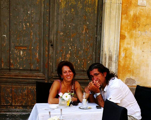 Table For Two Flower On Table The Portraitist - 2016 EyeEm Awards Enjoying Life Table Old Door Yellow Wall Green Door Love Street Photography People In Love People Rome Italy❤️ Italy Italia Roma Romantic EyeEm