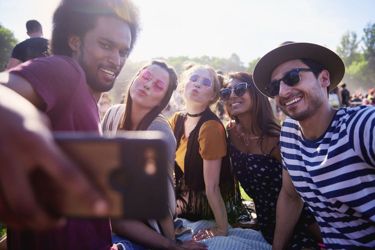 Man taking selfie with friends in party