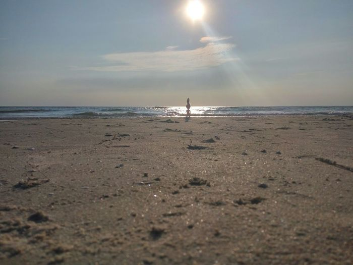 Silhoute on the beach shore Doll Figure Seashore Silhouette Sea Wave Beach Sand Swimming Summer Low Tide Sky Horizon Over Water