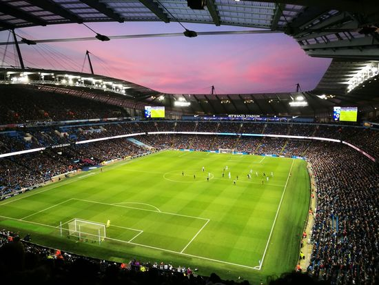 No filter needed Etihad Stadium Soccer Event Sport Stadium Floodlit Outdoors People Sunset Purpleskies Football Spectator Premier League Manchester ManchesterCity Blue Moon
