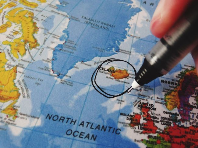 Circling Iceland. Map Business Travel Journey Human Hand Politics Human Body Part Close-up Indoors  Day People Circling Circle Iceland Vacations Vacation Holiday Holidays Atlas Direction Tourism Traveling Travel Destinations World Map Pen