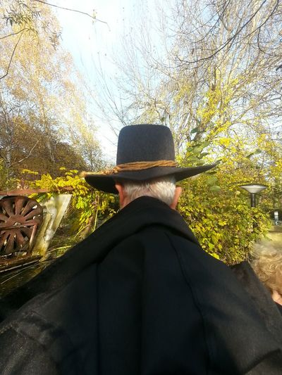 Rear view of man against trees against sky