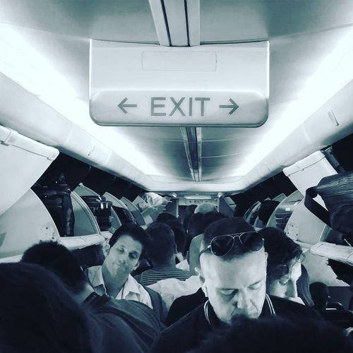 Get me outta here Daytrip Flying Plane Transportation Real People Group Of People Vehicle Interior Crowd Mode Of Transportation Travel