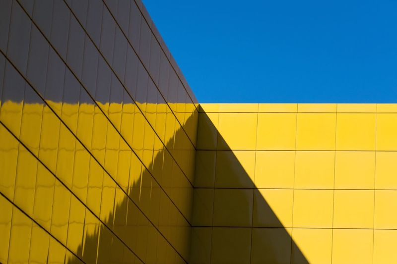 Low Angle View Of Yellow Wall Against Sky