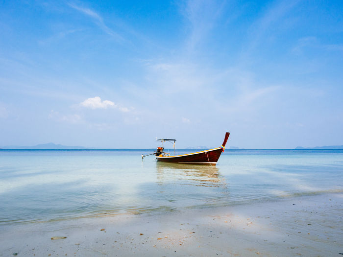 Longtail boat at Koh Kradan Beach Beauty In Nature Boat Day Horizon Over Water Longtail Boat Mode Of Transport Nature Nautical Vessel No People Outdoors Scenics Sea Sky Thailand Tranquil Scene Transportation Travel Destinations Water
