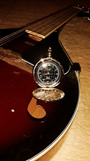 Grandfather clock and a musical instrument called a Russian balalaika :) Photo♡ By My Cam Design Beshkake Kergestan Russia
