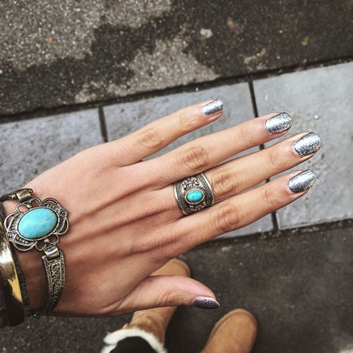 Cropped hand of fashionable woman